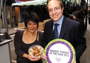 Carol Wong and Cllr Thomson in the market